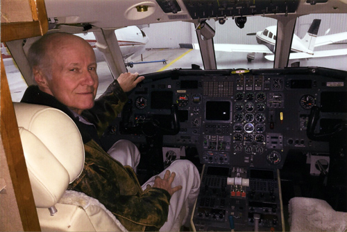 Allan E. in the cockpit after the FAA approved his return to flying, post surgery.