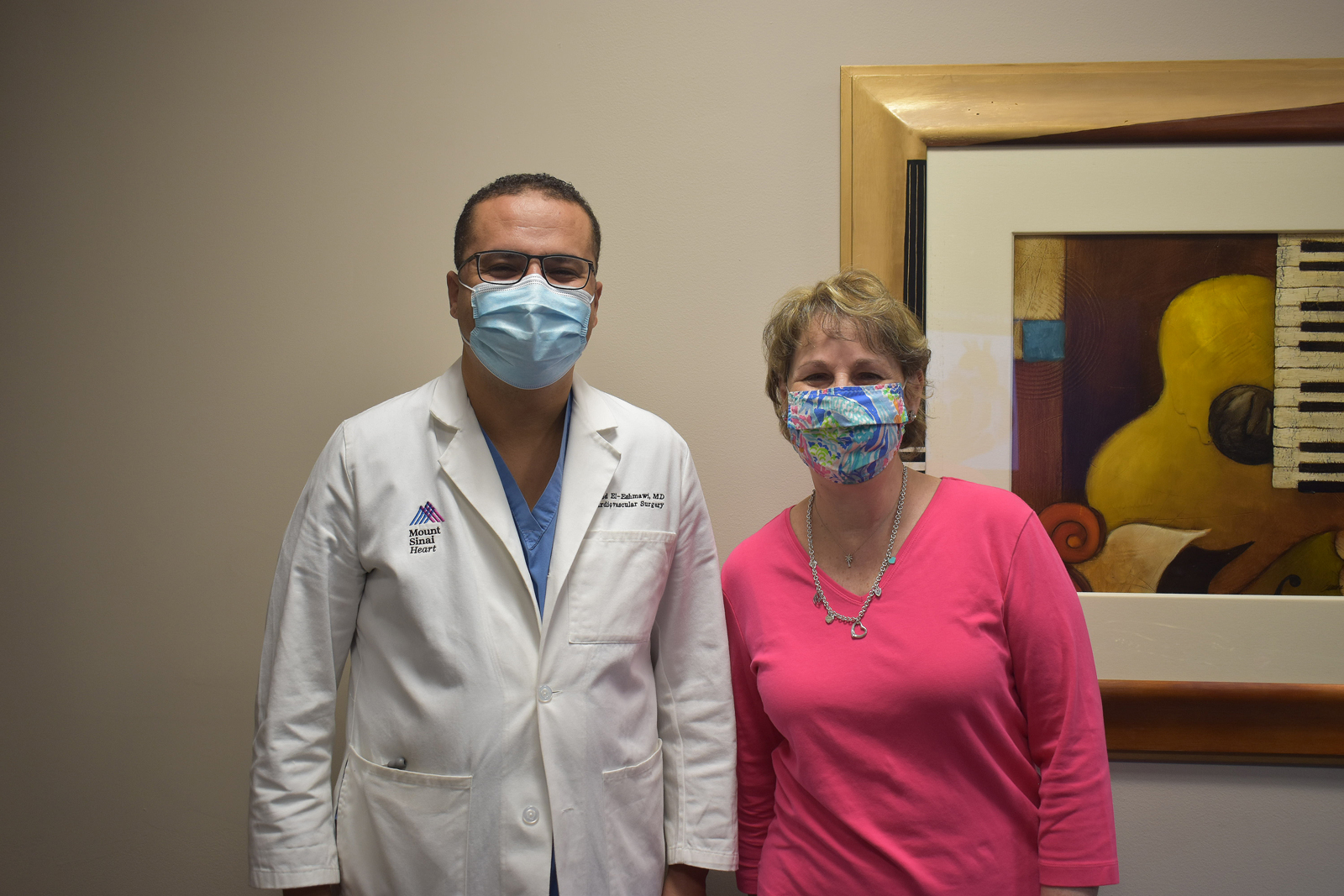Dr. El-Eshmawi and Laurie during a follow-up visit 11 months after her surgery.