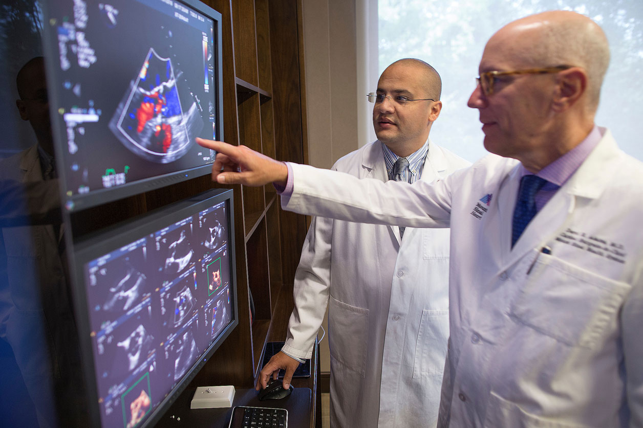 Drs. Adams and El-Eshmawi review a patient's echocardiogram during a surgical consultation visit.